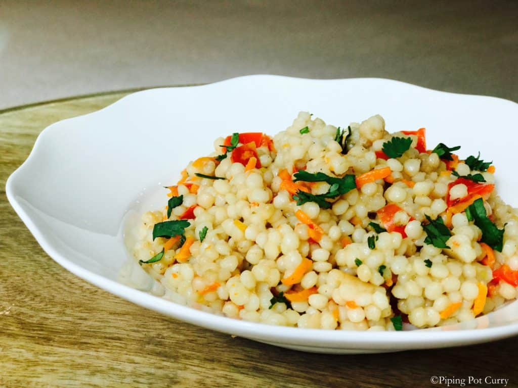 Couscous pulao in a white plate made in instant pot pressure cooker