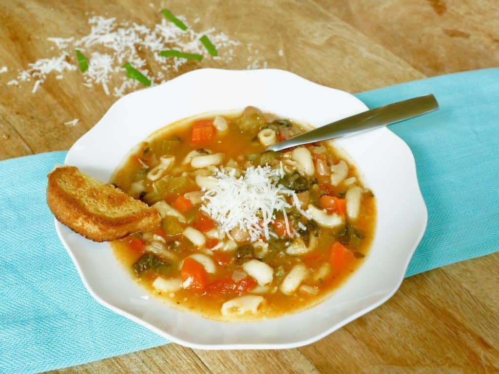 A perfect soup that is a complete meal in itself - Beans, loads of veggies and pasta, topped with cheese and a side of bread. Vegetarian friendly and can easily be made gluten-free and vegan.