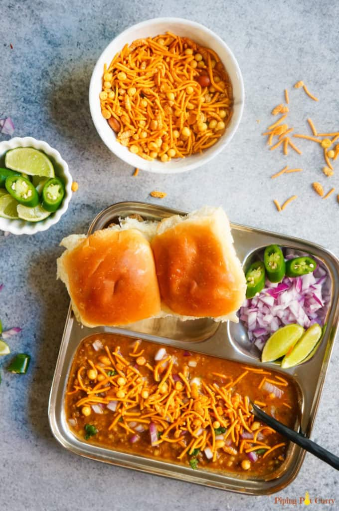 A delicious Mumbai breakfast, Misal Pav made as a one-pot recipe in the Instant Pot. Misal is a spicy sprouts curry cooked with onions, tomatoes, ginger, garlic and coconut. This is then topped with onions, lemon juice, farsan and enjoyed with pav (dinner rolls)