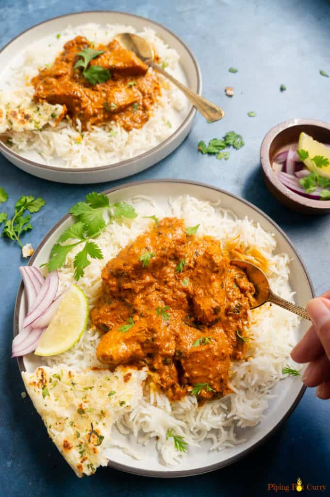 Instant Pot Chicken Tikka Masala - served over rice in two plates