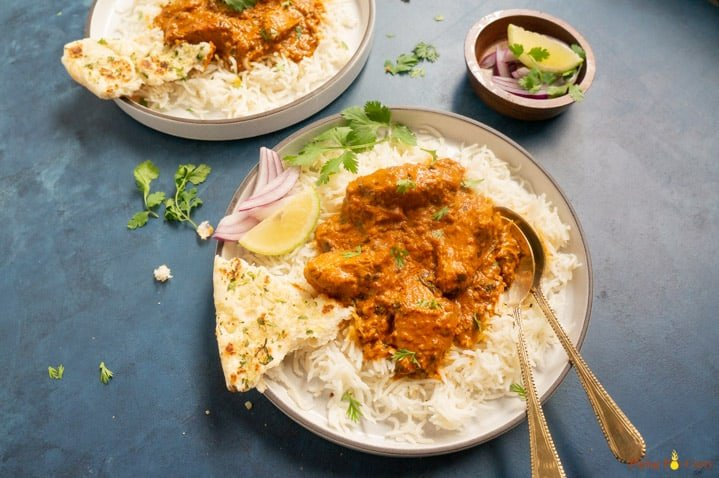 Instant Pot Chicken Tikka Masala served over rice along with naan on the side