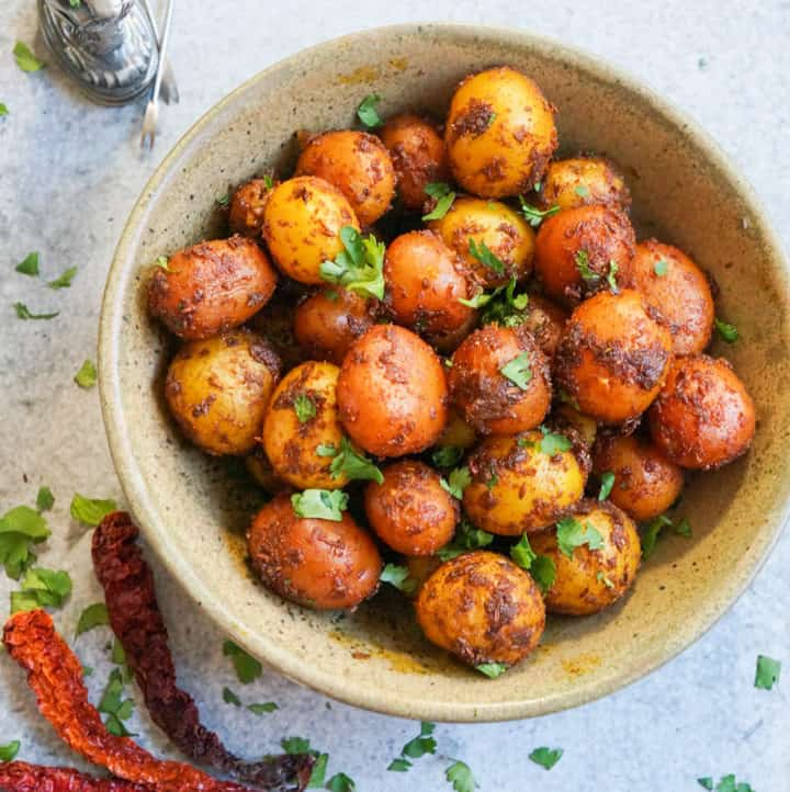 Spicy Bombay Potatoes made in Instant Pot Pressure Cooker in a bowl topped with chopped cilantro