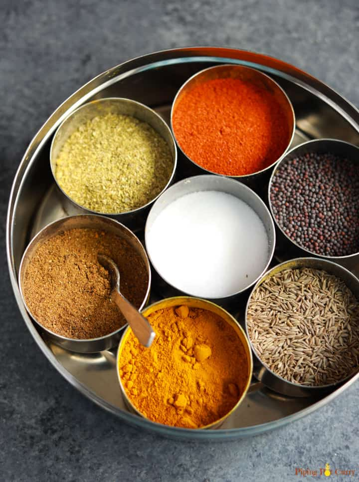 Spice box or Masala dabba with a variety of spices